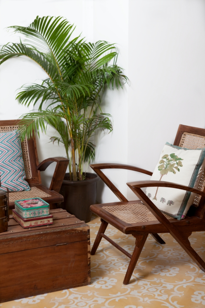 20th Century colonial and art deco hardwood and wicker furniture has been sourced from Bombay's second hand markets and lovingly restored. Upholstery and seat cushions have been made by local Indian designers.  Photo by Prarthna Singh courtesy of Abode.